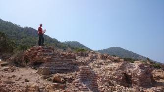 Hilal Küntüz is drawing the bath complex on Dana Island
