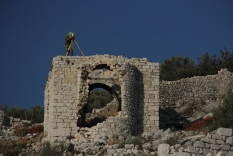 """Alihan Keskin by the Total Station placed on Church V (""""Martyrion"""")"""